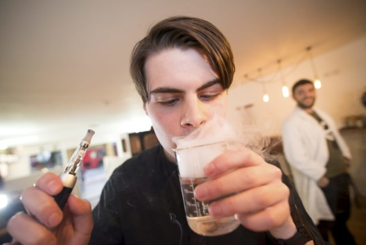 Smokers enjoying e-cigarettes and coffee at Vape bar at the Shoreditch, London on the 20/03/2014. Photo: David Tett
